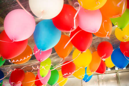 ceiling light: Colorful balloons floating on the ceiling of a party Stock Photo