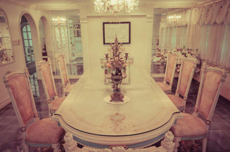Head of the table in the grand dinning room in old retro style photo