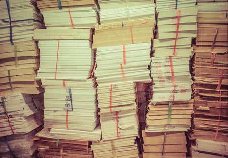 storeroom: stack of old books and documents pile up together in retro color