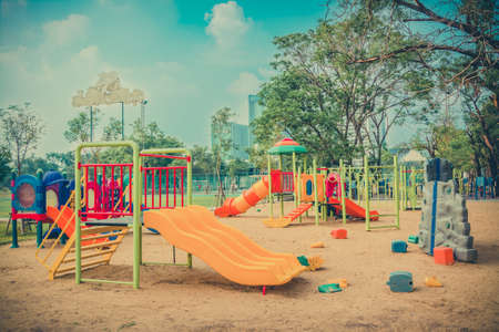 Children playground leftover in the park in vintage color photo
