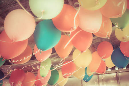 carnival party: Colorful balloons floating on the ceiling of a party in vintage color