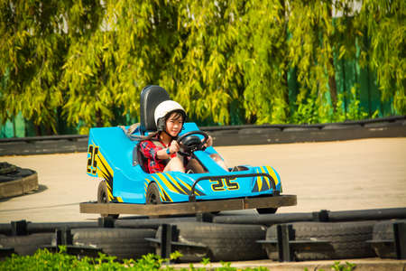 Cute Thai girl is driving Go-kart with speed photo