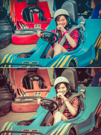 Cute Thai girl is driving Go-kart with speed from the starting point in vintage and childhood color set photo