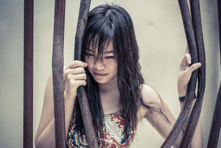 Asian Thai girl is bending the prison bar with her power photo