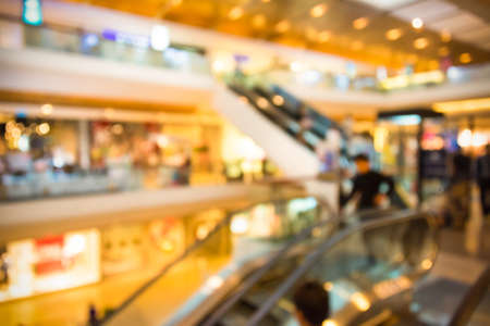 Blur background photograph of people in the department store building with huge escalator photo