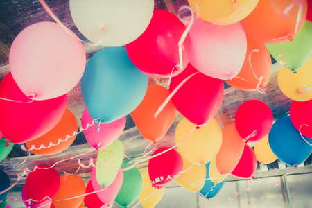 ceiling: Colorful balloons floating on the ceiling of a party in vhildhood memory