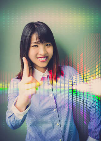 Asian office girl lifting her forefinger, showing for confidence in business analysis with colorful abstract light photo