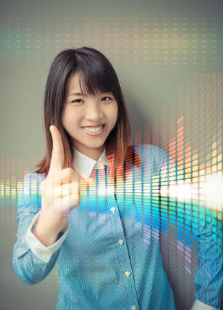 confidence: Asian office girl lifting her forefinger, showing for confidence in business analysis with colorful abstract light