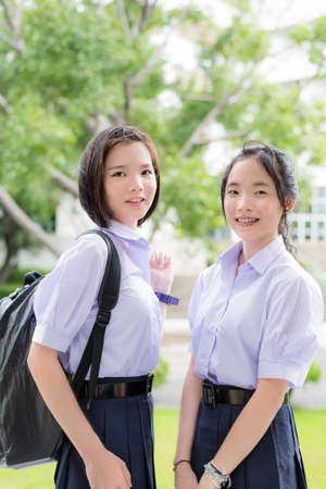 thai student: Cute Asian Thai high schoolgirls student couple in school uniform standing with her friend in a happy smile face expression Stock Photo