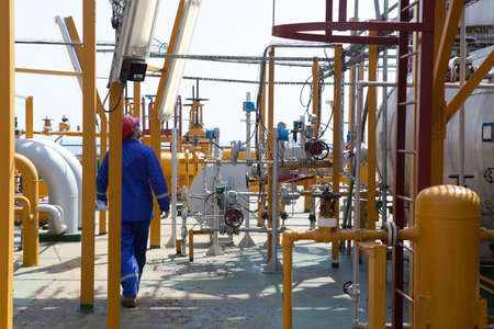 energy work: Engineer monitoring and controling system at rig.