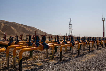 Oil and gas valves in field Stock Photo