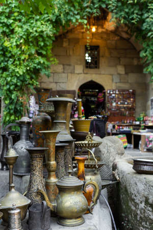 Old oriental antiques barass jungs and vases on street market in Baku, Azerbeijan.