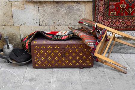 Ancient oriental handmade carpets at Old Town Baku streets. Baku Azerbaijan.