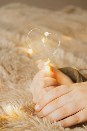 Happy Valentines Day with Heart Shaped Light in Girls Hands Reklamní fotografie