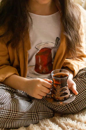 Girl with a Cup of Tea in her Hands
