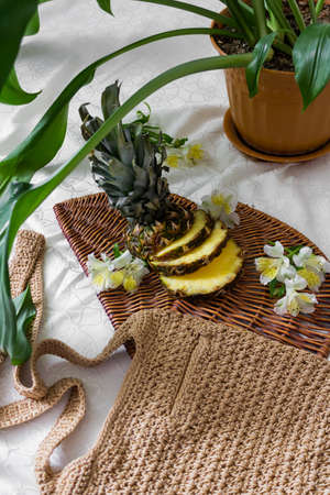 Large cut pineapple, bag and leaves