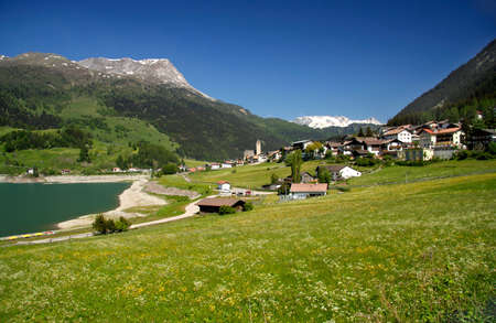 lakeshores: View of the village Resia (Reschen) in South Tyrol, Italy Stock Photo