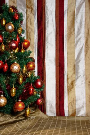 Close-up of Christmas tree with striped silk backdrop photo
