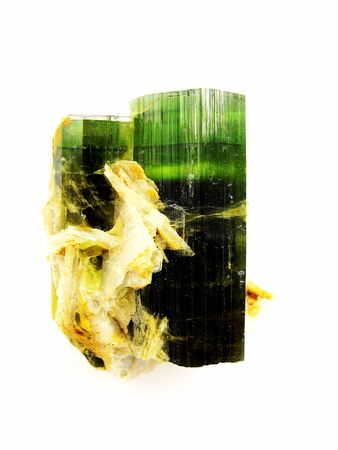 central nervous system: Two green Tourmaline crystals, var. Verdelite, from Northern provinces Pakistan. Of interest to jewellers, collectors and in alternative medicine - energises central nervous system