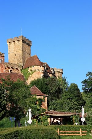 commune: Chateau de Castelnau-Bretenoux situated in the commune of Prudhomat, Lot, France, is an impressive military chateau begun in 1100 and enlarged during the 12th to 15thC as it was adapted to artillery