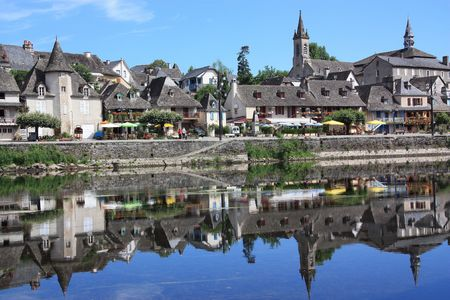 both sides: The Quays at Argentat, Correze, France which is a beautiful historical town spanning both sides of the Dordogne river Stock Photo