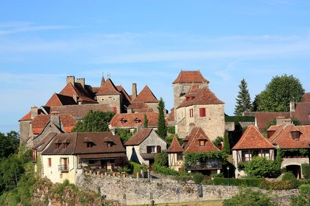 """A view across to Loubressac, Lot, France, a fortified hilltop village which is listed as one of the 152 """"plus beaux villages""""  """" most beautiful villages"""" of France"""