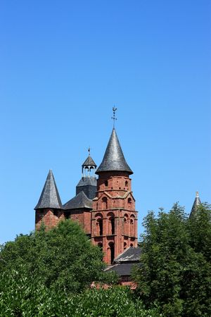 classed: The church spires of Collonges la Rouge, Limousin, France which is classed as one of the 152 officially desinated Most Beautiful Villages of France and is known for its red stone architecture