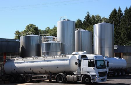 Two refrigerated tankers deliver the early morning load of fresh milk from the surrounding farms to the dairy. photo