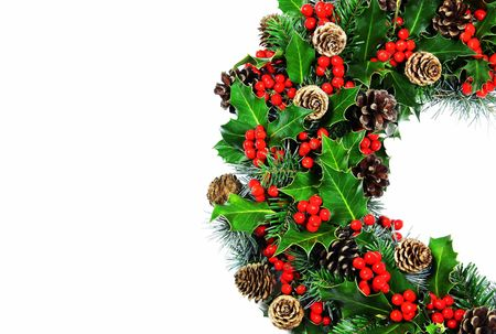 A tradional Christmas holly wreath of natural holly, cypress, pine and cones on a white background with very soft natural shadow. photo