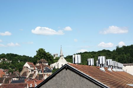 vents: The rooftop of an apartment block with multiple air ventilation systems dominates the old town centre
