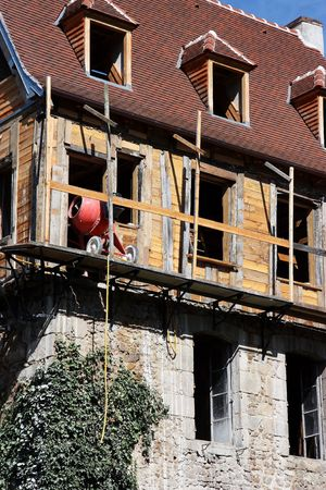 sheathing: DIY renovations to an ancient dwelling showing recycling of old materials. Stock Photo