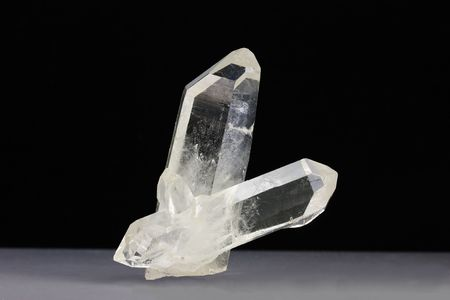 terminated: Two Quartz crystals, one  doubly terminated, which is of particular interest in alternate medicine and crystal healing as the double termination increases the energy. It  is also an electrical conductor used in crystal oscillators and optical equipment Stock Photo