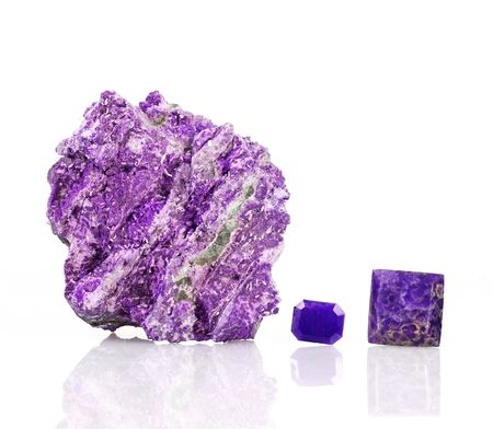 Sugilite or Luvulite microcrystals, the Healer Stone, with polished cabochons Stock Photo