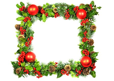 rectangular: A Christmas frame of red baubles and natural holly with red berries, cones and spring foliage from cypresses with vivid green new growth photographed over white. Stock Photo