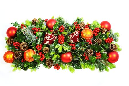 Christmas holly, natural foliage, baubles and a bow  photo