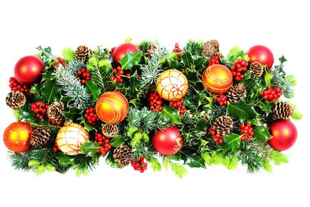 Christmas decoration of natural holly and foliage, cones and baubles photo