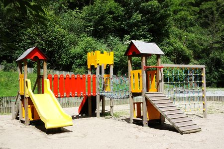 climbing frames: A childrens playground with a slide and climbing frames. Stock Photo