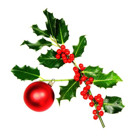 Sprig of Christmas Holly with red berries and a bauble. Stock Photo