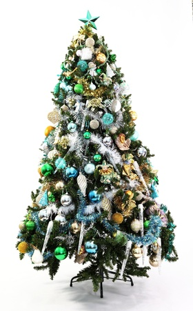 Blue, Gold, Green decoratons in a series of colour themed Christmas trees each with different decorations photographed over white with soft shadow at the base