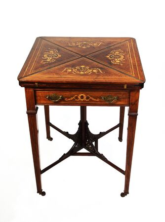 An antique inlaid rosewood envelope card table photographed over white