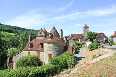 classed: View along the main road of the historic village of Autoire, Lot, France, classed as one of the Most Beautiful Villages of France and a popular tourist destination Stock Photo