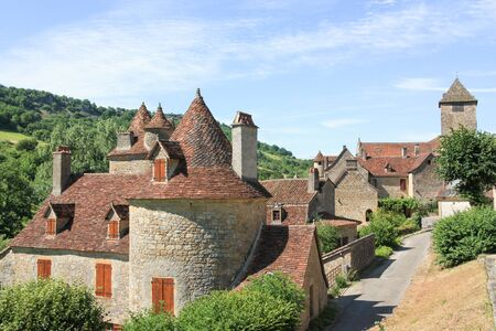 classed: Stone buidlings in the historic village of Autoire, Lot , France, classed as one of the plus beaux villages , or Most Beautiful Villages, of France and a popular tourist village