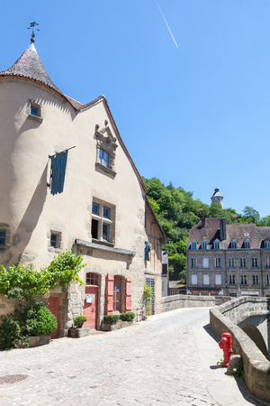 weavers: Aubusson, Creuse, France, June 2015, Medieval Pont de Terrade and the Clock Tower,  crossing the River Creuse leading to the weavers quarters for the  500 year old  French tapestry industry