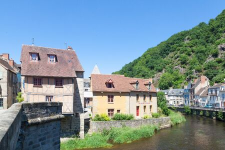 weavers: June 2015, Aubusson, Creuse, Limousin, France -  a view of the medieval tapestry weavers quarter and one of the tapestry museums with the Pont de terrade and River Creuse Editorial