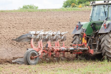 ploughing field: Close up detail of a plough, or plow, ploughing an overwintered fallow field ready for planting the spring crop Stock Photo