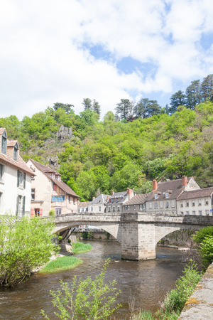 weavers: View of the medieval Pont de la Terrade over the River Creuse, Aubusson, Creuse, Limousin, France linking the tapestry manufacters with the old weavers quarters