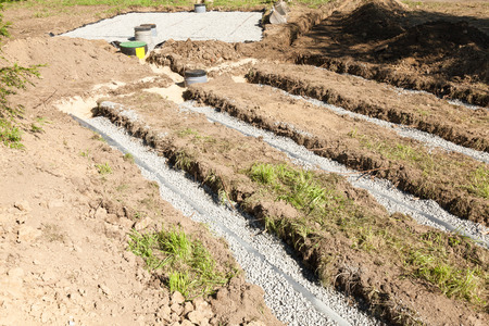 tank: Detail of a secondary filter bed  on a septic tank installation showing the position of the pipes with the primary bed behind, necessitated by clay soil and poor drainage
