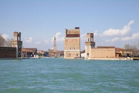 Venice, Veneto, Italy, Renaissance Porta Nuova Tower and lagoon entrance to Arsenale in Castello, a medieval shipyard and armoury, Stock Photo