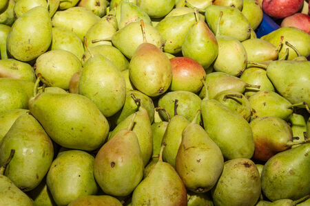 Delicious ripe fresh juicy pears at local market photo