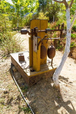 oka: Old wooden heavy weight scales, with metal counterweights and an 100 oka weight